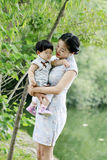 Family fun time, Chinese woman and baby in cheongsam enjoy free time Royalty Free Stock Photo