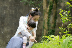 Family fun time, Chinese woman and baby in Hanfu dress enjoy free time Royalty Free Stock Photos