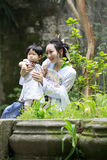 Family fun time, Chinese woman and baby in Hanfu dress enjoy free time Stock Image