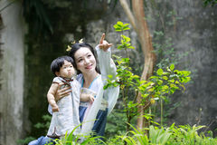 Family fun time, Chinese woman and baby in Hanfu dress Stock Photography