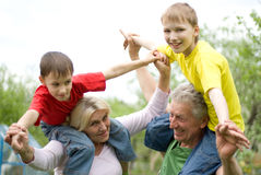 Family fun to play. Portrait of a happy family fun to play outdoors Stock Images