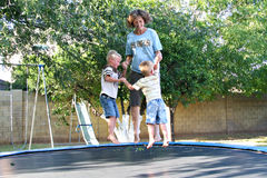Family Fun on the Trampoline royalty free stock photos