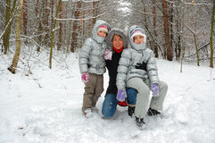 Family fun in winter forest Royalty Free Stock Photos