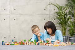 Family fun with wooden blocks Stock Images