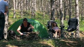 Family fun in the woods with a tent. stock video footage