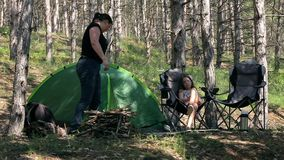 Family fun in the woods with a tent. stock video