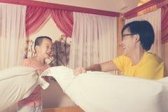 Family funny pillow fight Stock Photos