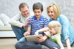 Family with gadgets Royalty Free Stock Images