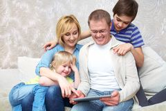 Family with gadgets Stock Photo