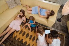 Family with gadgets Royalty Free Stock Photography
