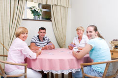 Family game. Family playing cards game together in living room Royalty Free Stock Photography