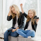 Family games. Mother and daughter play on conlsole together. Emotions. Family games. Mother and daughter play on colsole together Stock Images