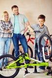 Family in garage Stock Photo