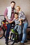 Family in garage Stock Photography