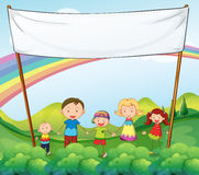 A family in the garden with an empty banner Stock Photography