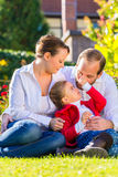 Family on the garden lawn Stock Photography