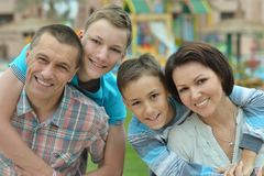 Family  in  garden at vacation resort Stock Images
