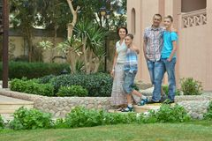 Family  in  garden at vacation resort Stock Photos