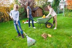 Family gardening. At backyard in autumn Royalty Free Stock Image