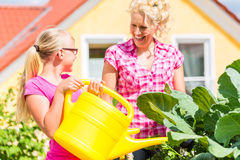 Family gardening in front of their home Stock Photos