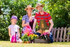 Family gardening in garden Stock Photos