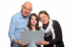 Family gathered around a notebook royalty free stock photo