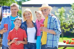 Family gathering. Portrait of happy parents with children and grandpa outdoors stock images