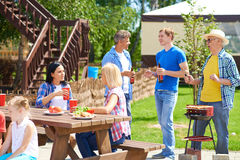 Family gathering. Relatives spending time together in summer Royalty Free Stock Photography