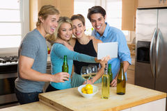 Family gathering selfie party on a tablet two couples on a double date Royalty Free Stock Photo