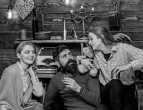 Family gathering, spending time together. Woman with happy smile watching her husband and teenage kid talking. Girl. Discussing something with father. Bearded stock photo