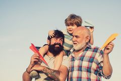 Family generation: future dream and people concept. Boy with father and grandfather. Male multi generation portrait royalty free stock images
