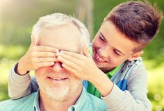 Grandfather and grandson playing at summer park royalty free stock image