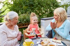 Mother, daughter and grandmother at cafe Royalty Free Stock Photography