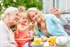 Happy family taking selfie at cafe Royalty Free Stock Photo