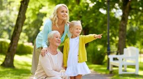 Happy mother, daughter and grandmother at park stock photo