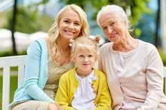 Woman with daughter and senior mother at park royalty free stock photo
