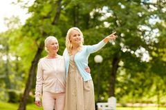 Daughter with senior mother at park Royalty Free Stock Images