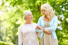 Daughter with senior mother at park Stock Photos