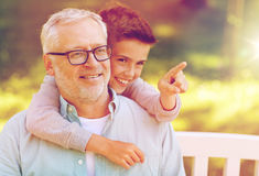 Grandfather and boy pointing finger at summer park Stock Images