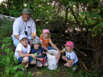 Family Geocaching. Image of a family geocaching in the Utah forest Stock Images