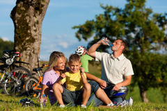 Family on getaway with bikes Stock Photo