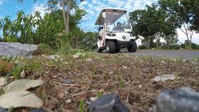 Family Getting in Golf Cart stock video