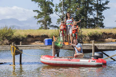 Family Getting Into Inflatable Boat For Fishing Trip Royalty Free Stock Image