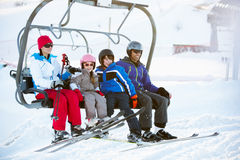 Family Getting Off Chair Lift On Holiday. Family Getting Off chair Lift On Ski Holiday In Mountains Stock Images