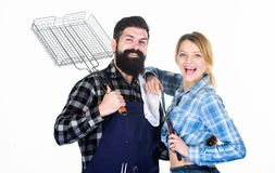 Family getting ready for barbecue. Backyard barbecue party. Cooking together. Essential barbecue dishes. Bearded hipster royalty free stock images