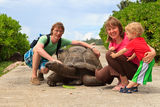 Family with giant turtle Royalty Free Stock Photo