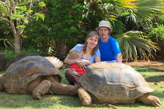 Family with giant turtle Stock Photos