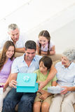 Family gifting birthday present to man Stock Images