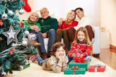 Family with gifts at christmas tree Stock Photos