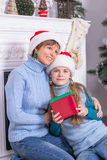 Family with gifts near a Christmas tree. Stock Photography